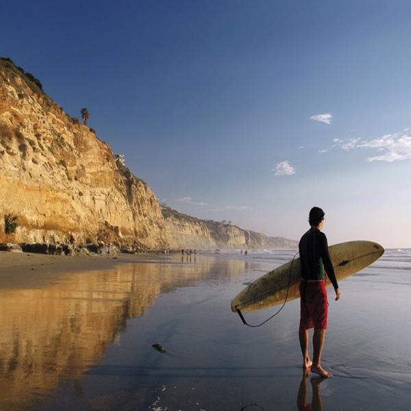 Surfer on beach CA