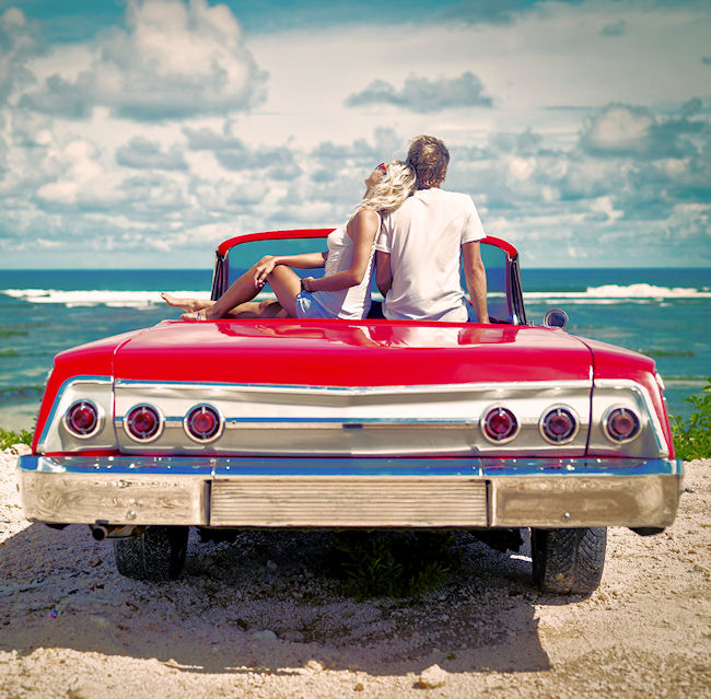 couple sitting on car