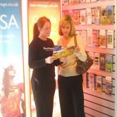 Sandie & Gemma reading brochure