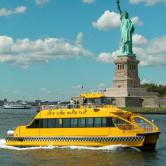 New York water taxi and statue